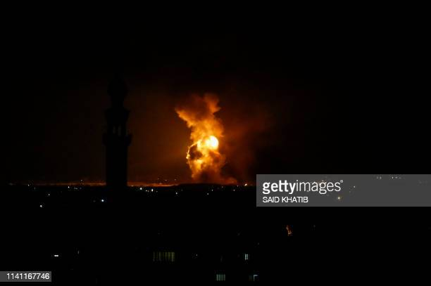 Picture taken in Rafah in the southern Gaza Strip, on May 5, 2019 shows an explosion following an airstrike by Israel. - Gaza militants fired a...