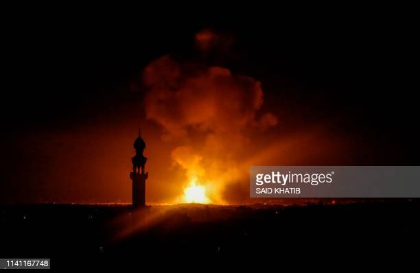 TOPSHOT A picture taken in Rafah in the southern Gaza Strip on May 5 2019 shows an explosion following an airstrike by Israel Gaza militants fired a...
