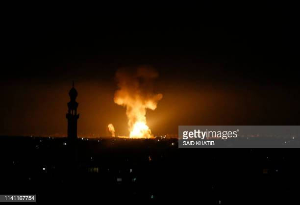 A picture taken in Rafah in the southern Gaza Strip on May 5 2019 shows an explosion following an airstrike by Israel Gaza militants fired a barrage...