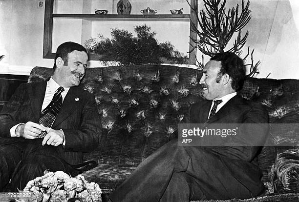 A picture taken in September 1973 shows Algerian President Houari Boumediene and Syrian President Hafez alHassad during Boumediene's official visit...