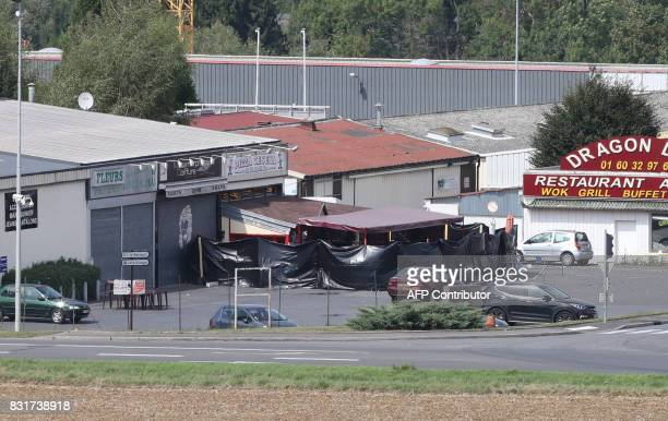 A picture taken in SeptSorts 55km east of Paris on August 15 2017 shows a pizza restaurant covered by a black tarpaulin a day after a car crashed...