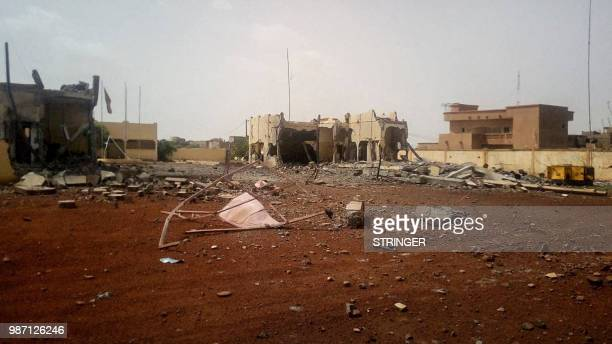 A picture taken in Sevare in central Mali on June 29 2018 shows debris scattered in front of the head quarter of the antiterror task force the G5...