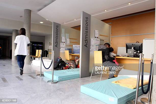 A picture taken in Tarbes on December 7 2016 shows mattresses on the floor at the entrance of the Polyclinique de L'Ormeau during a strike by...