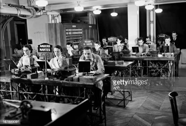 A picture taken in the 1930s in Paris place de la Bourse at the French press Agency Havas shows press employees transmitting news to the agency's...