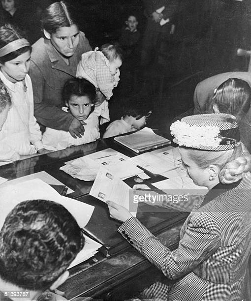Picture taken in the 1940s in Buenos Aires of Eva Peron taking care of children Eva Peron known as Evita the second wife of Argentine President Juan...