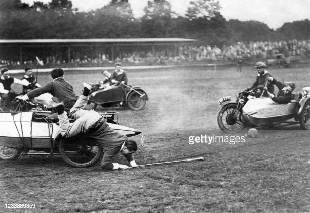 Picture taken in the 30s of Englishmen playing polo on Sidecar, in United Kingdom.