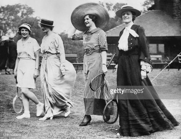 Picture taken in the 30s of women displaying different tennis long dresses at the tennis Aigburth festival in Liverpool.