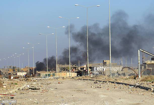 A picture taken in the early hours on December 27 2015 shows smoke billowing in Ramadi's Hoz neighbourhood about 110 kilometers west of the Iraqi...