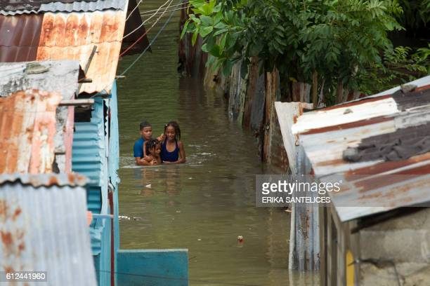 TOPSHOT Picture taken in the flooded neighbourhood of La Puya in Santo Domingo on October 4 2016 after the passage of Hurricane Matthew through...