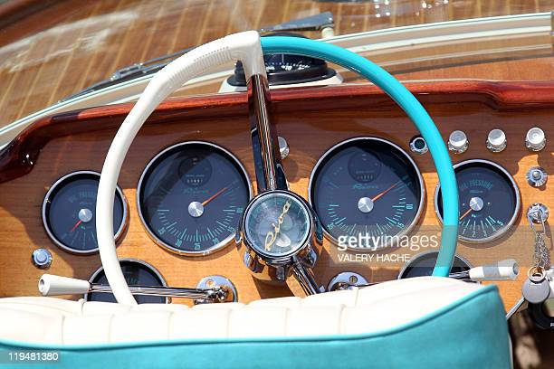 A picture taken in the Monaco harbor on July 11 2011 shows a Riva speedboat dashboard icon of the Made in Italy luxury design Like many symbols of La...