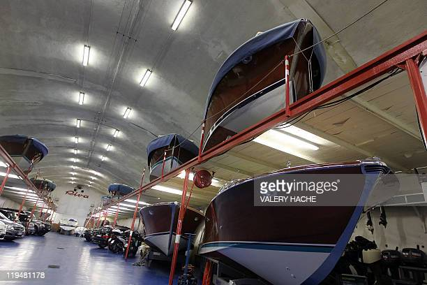 A picture taken in the Monaco harbor on July 11 2011 shows drydocked Riva speedboats icons of the Made in Italy luxury design Like many symbols of La...