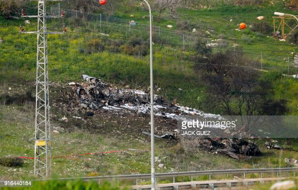 A picture taken in the northern Israeli Kibbutz of Harduf on February 10 shows the remains of an Israel F16 that crashed after coming under fire by...