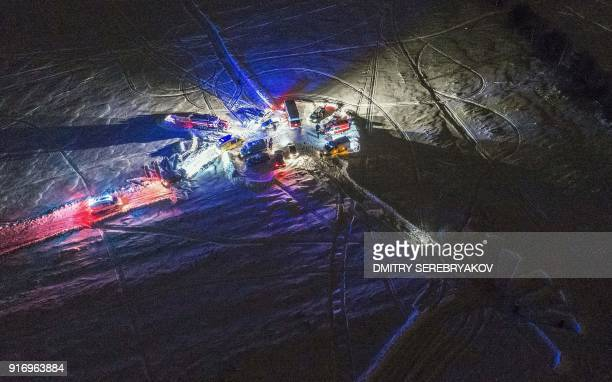 TOPSHOT A picture taken in the Ramensky district on the outskirts of Moscow on February 11 2018 shows an aerial view of Russian emergency vehicles...