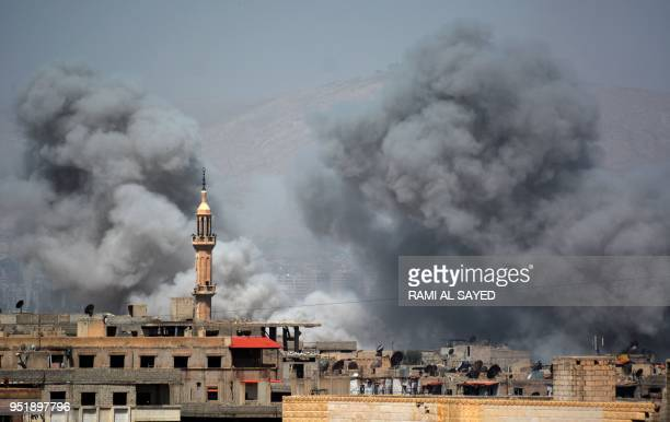 TOPSHOT A picture taken in the Yarmuk Palestinian refugee camp in southern Damascus on April 27 2018 shows smoke billowing in the area during Syrian...