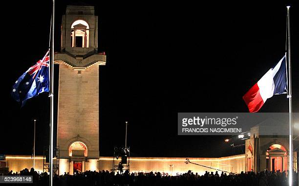 A picture taken in VillersBretonneux on April 25 2016 shows the Australian National flag and French National flag fluttering at the Australian...