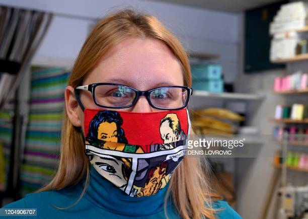 A picture taken in Zagreb on March 3 shows a woman wearing a protective face mask designed by Croatian designer Zoran Aragovic Triggered by...