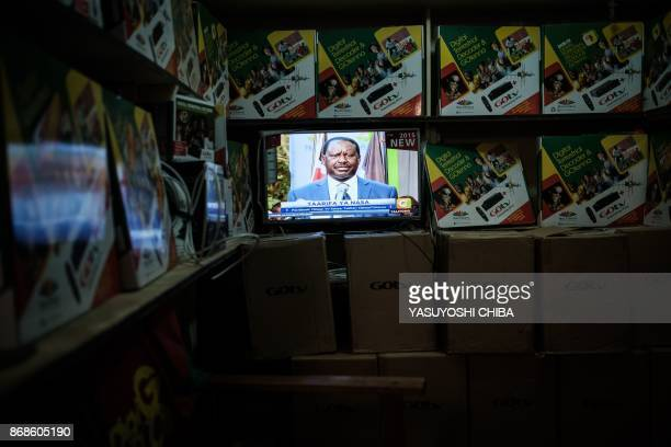 A picture taken inside an electrical items shop in Kisumu on October 31 2017 shows Raila Odinga leader of the National Super Aliance the Kenya's main...