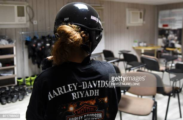 A picture taken June 3 2018 shows Saudi Noura fastening her helmet ahead of a training session at the Bikers Skills Institute a motorcycle driving...