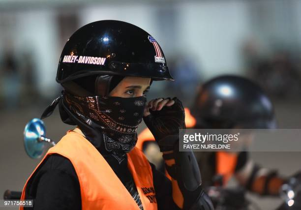 A picture taken June 3 2018 shows Saudi Noura preparing for a training session at the Bikers Skills Institute a motorcycle driving school on the...