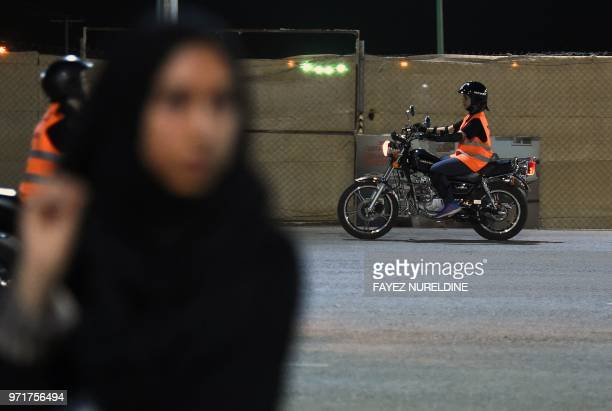 A picture taken June 3 2018 shows Saudi Noura taking part in a training session at the Bikers Skills Institute a motorcycle driving school on the...