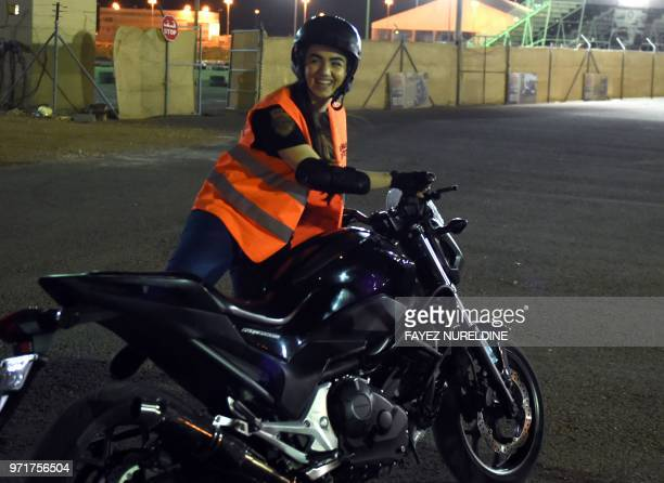 A picture taken June 3 2018 shows Saudiborn Jordanian Leen Teenawi preparing for a training session at the Bikers Skills Institute a motorcycle...