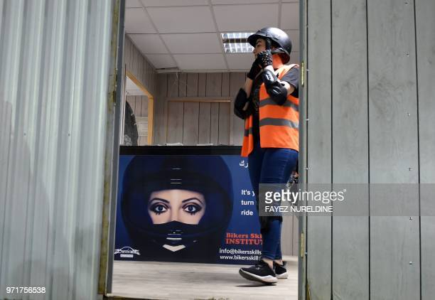 A picture taken June 3 2018 shows Saudiborn Jordanian Leen Teenawi fastening her helmet ahead of a training session at the Bikers Skills Institute a...