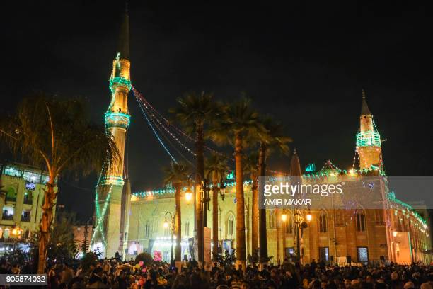 A picture taken on January 16 2018 shows a general view of crowds arriving outside alHussein mosque in Cairo to attend a ceremony commemorating the...