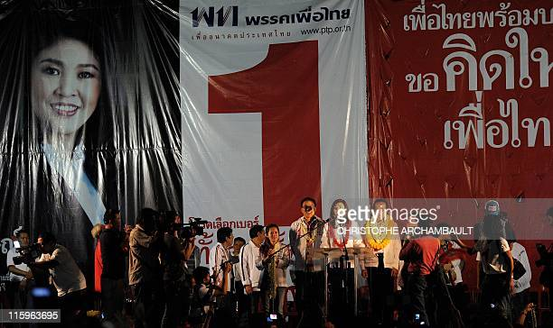 Picture taken late on June 12 2011 shows candidate for the opposition Puea Thai party Yingluck Shinawatra the sister of former prime minister Thaksin...