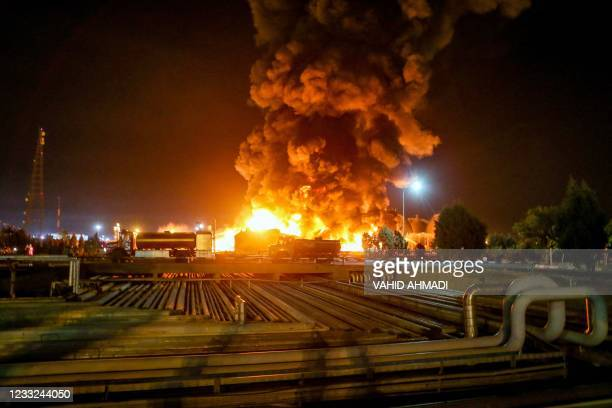 Picture taken late on June 2 shows fire raging at an oil refinery in the Iranian capital Tehran. - A fierce blaze broke out at the refinery in...