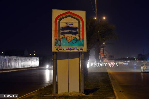 Picture taken late on November 3, 2019 shows the name of Khomeini street in the central Iraqi city of Najaf covered with black paint and replaced...