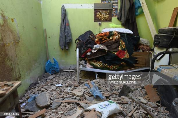 TOPSHOT A picture taken March 26 2018 in Um AlHammam district in Riyadh shows damages at a home hit by falling shrapnel from Yemeni rebel missiles...