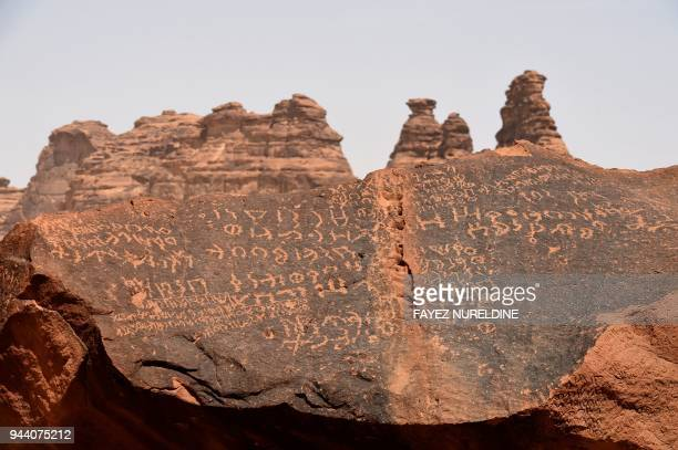 A picture taken March 31 2018 shows inscription on rosecoloured sandstone in the Nabataean archaeological site of alHijr near the northwestern town...