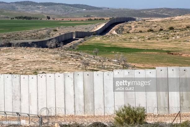 A picture taken near the southern kibbutz of Lahav on February 7 shows the controversial Israeli separation wall dividing Israel from the West Bank /...