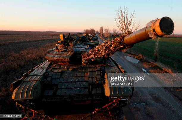 A picture taken near Urzuf village not far from the city of Mariupol eastern Ukraine on November 29 2018 shows Ukrainian tanks during military drills...