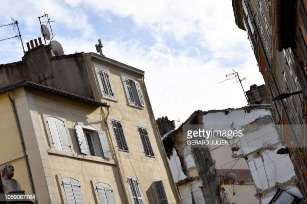 Picture taken November 8, 2018 shows kitchen placards and the remaining of a destroyed facade following the collapse of two buildings earlier during...