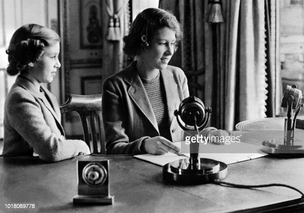 Picture taken October 1940 in Windsor shows the Britain's Princess Elizabeth and her sister Princess Margaret sending a message during the BBC's...