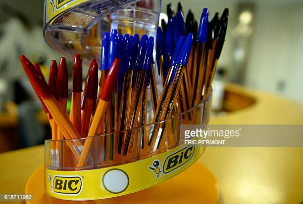 A picture taken October 27 2016 shows ballpoint pens of the French pens shavers and lighters maker Bic displayed at the Bic plant manufacturing of...