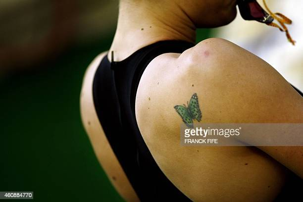Picture taken of a butterfly tattoo on the shoulder of French Laure Manoudou as she is waiting for the start of the women's 800 Meter Free Style...