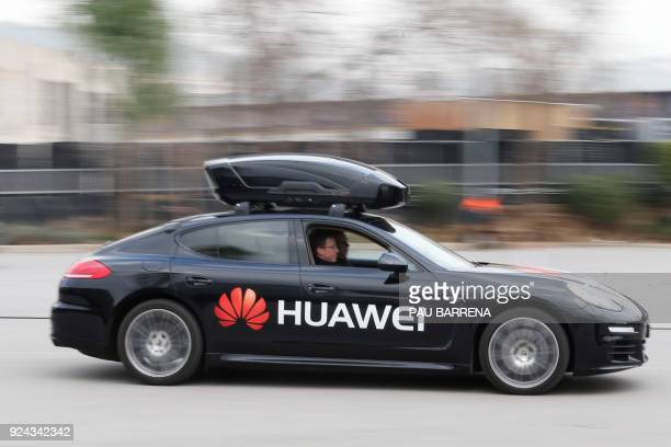 Picture taken of a Porsche Panamera car driven by the Huawei Mate 10 Pro smartphone outside the Camp Nou stadium in Barcelona on February 26 on the...