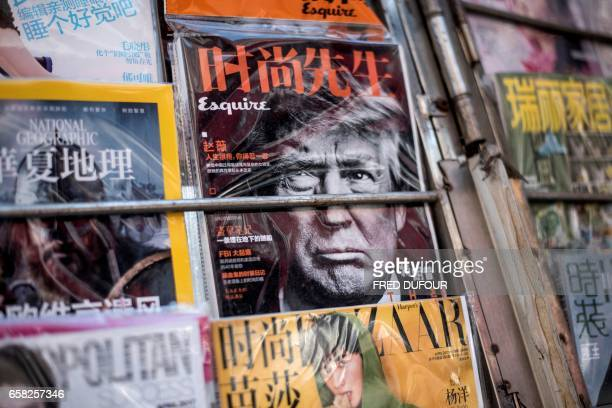Picture taken of Chinese magazines with US President Donald Trump on a cover in Beijing on March 27 2017 / AFP PHOTO / FRED DUFOUR