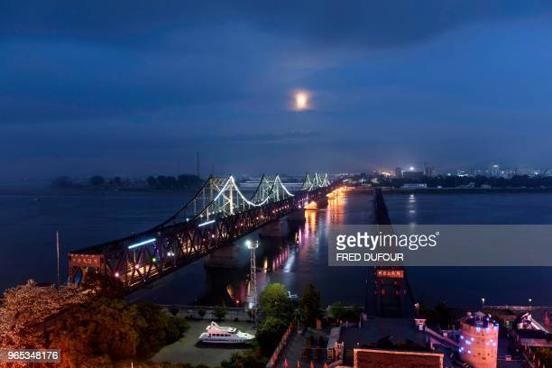 A picture taken of the 'Friendship Bridge' in the Chinese border town of Dandong in China's northeast Liaoning province on May 29 2018 The city of...
