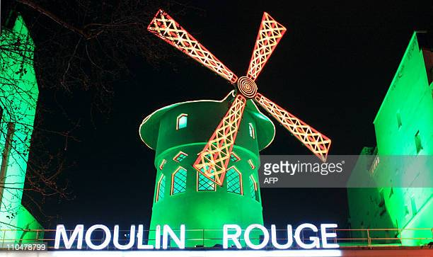 Picture taken of the Moulin Rouge cabaret illuminated in green to mark Saint Patrick's day on March 16 2011 in Paris AFP PHOTO / JOHANNA PYNEEANDEE