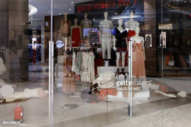 A picture taken on 13 January 2018 in Sandton City shopping mall in Johannnesburg shows the HM clothing store closed after members the Economic...
