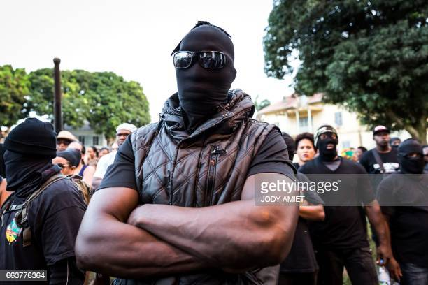 A picture taken on April 1 2017 shows members of the 500 brothers collective standing outside the prefecture in Cayenne French Guiana during...