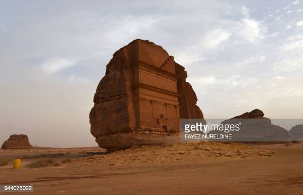 A picture taken on April 1 2018 shows a view of the Qasr alFarid tomb carved into rosecoloured sandstone in Madain Saleh a UNESCO World Heritage site...