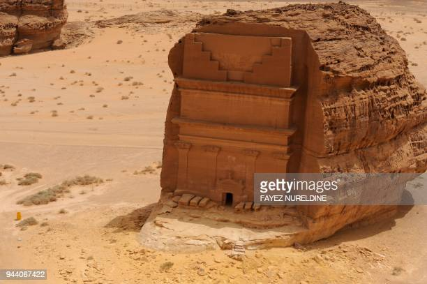 A picture taken on April 1 2018 shows an aerial view of the Qasr alFarid tomb carved into rosecoloured sandstone in Madain Saleh a UNESCO World...