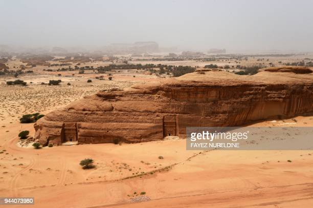 A picture taken on April 1 2018 shows an aerial view of tombs carved in rosecoloured sandstone in Madain Saleh a UNESCO World Heritage site near...