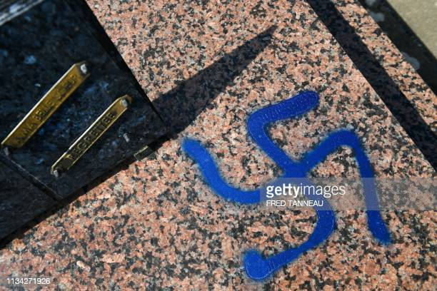 Picture taken on April 1, 2019 shows a grave vandalised with spray-painted swastikas at a cemetery in Ploermel, western France.