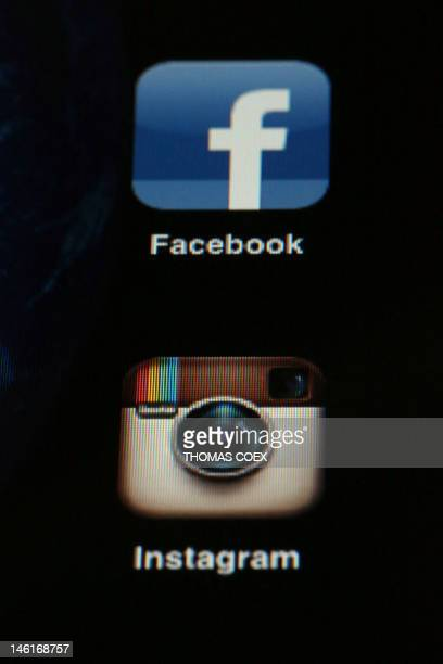 A picture taken on April 10 2012 shows the smartphone photo sharing application Instagram on an Iphone next to the Facebook application one day after...