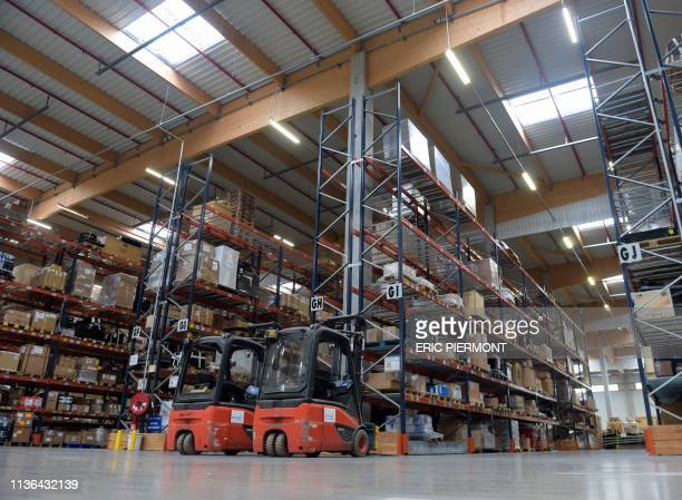 A picture taken on April 10 2019 shows the interior of French International transport and logistics company Bollore Logistics' hub at RoissyCharles...